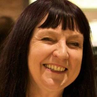 Author / Speaker holding image - Suzie Hanna