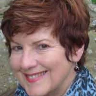 Author / Speaker holding image - Celia Rees