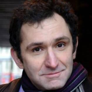 Author / Speaker holding image - Jonathan Stroud