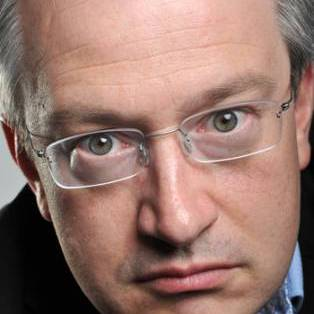 Author / Speaker holding image - Robin Ince