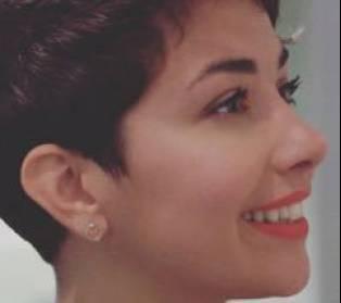 Author / Speaker holding image - Sahar Zand