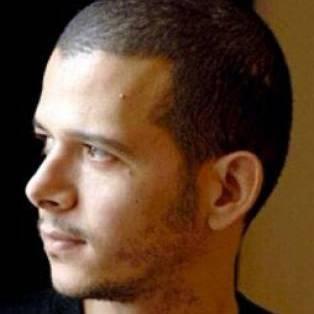 Author / Speaker holding image - Abdellah Taïa