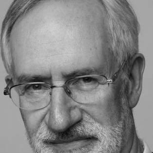Author / Speaker holding image - John McHugo