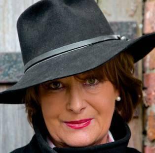 Author / Speaker holding image - Minette Walters
