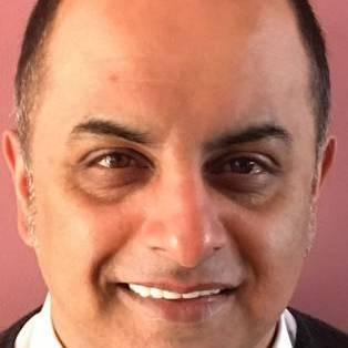 Author / Speaker holding image - Bali Rai