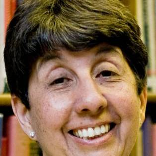 Author / Speaker holding image - Miriam Halahmy