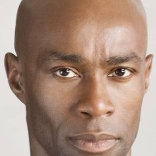 Author / Speaker holding image - Ben Arogundade