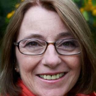 Author / Speaker holding image - Ambra Edwards