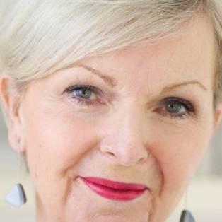 Author / Speaker holding image - Tricia Cusden