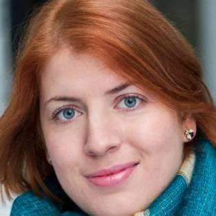 Author / Speaker holding image - Miranda Kaufmann