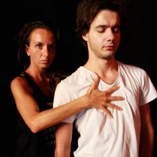 Author / Speaker holding image - NOMA Physical Theatre Company