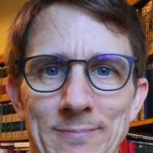 Author / Speaker holding image - Jon Balserak