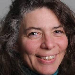 Author / Speaker holding image - Peggy Hollinger