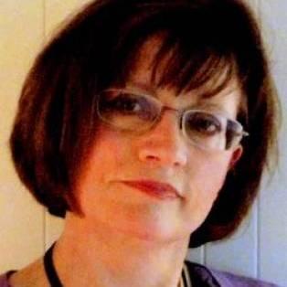 Author / Speaker holding image - Lynda Mugglestone