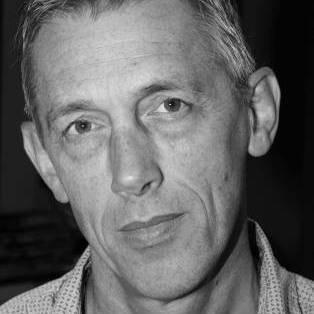 Author / Speaker holding image - Jonathan Bate